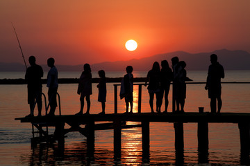 children are at pier during sunset in turkey