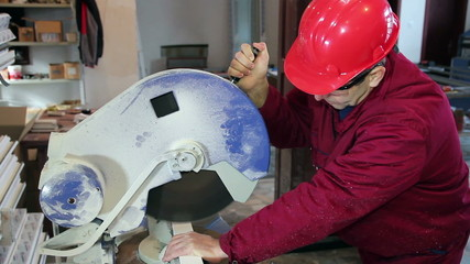 Worker Cutting PVC Profile with Circular Saw