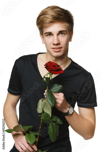 Young hansome man holding the red rose