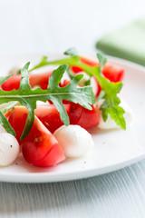 Close up of Caprese Salad with arugula leaves