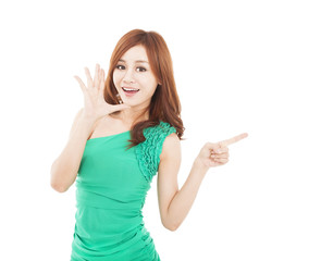 happy young woman shouting and pointing at something