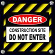 Danger sign over warning stripes background