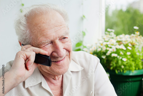 Old Man Enjoying a Telephone Conversation