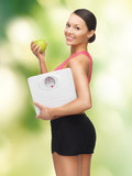 woman with apple and weight scale