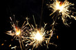 three burning sparklers, close-up