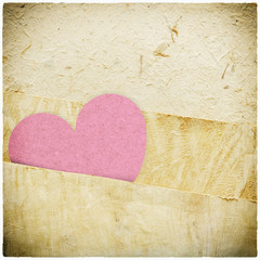 heart recycled paper stick on paper background Vignette photo an