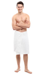 Young man wearing towel
