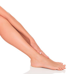 Well-groomed female legs after depilation procedure.