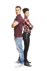 Upset young couple standing together