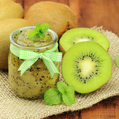 Closeup of delicious kiwi jam in a glass jar with mint