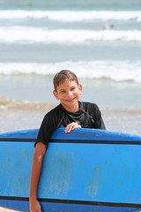 Young Boy with Surfboard