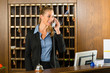 Reception of hotel - desk clerk taking a call