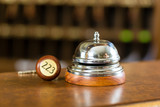 Reception - Hotel bell and key lying on the desk - 49214074