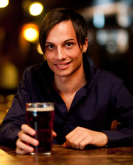 Man drinking a beer in a pub