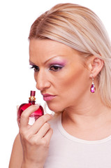 Woman thinking abour perfume