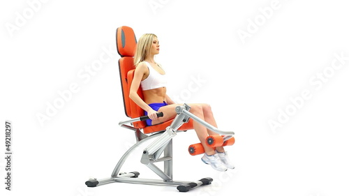 Young woman on orange exerciser