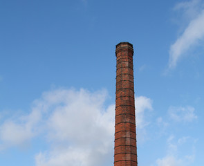 A Traditional Brick Built Tall Industrial Chimney.