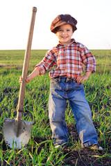 Smiling boy with shovel