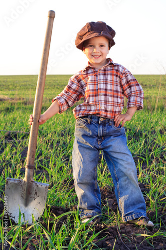Smiling boy with shovel