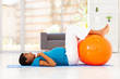 pregnant african woman workout on exercise mat at home