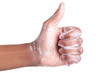 Soapy African American womens hand making thumbs up