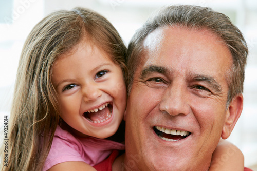 Portrait Of Grandfather With Granddaughter