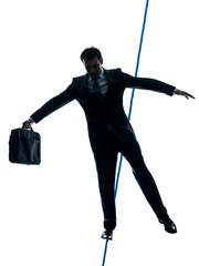 Businessman  tightrope walker silhouette