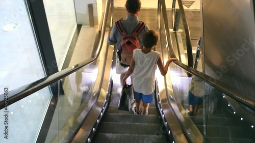 Father and son in the escalator