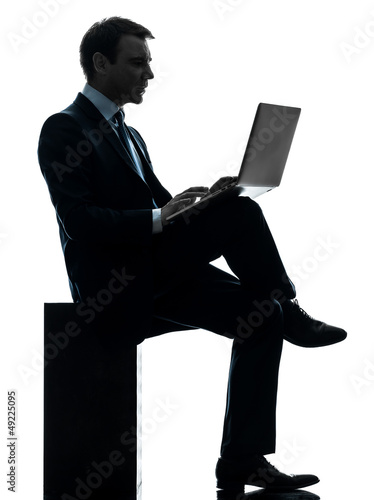 business man computing laptop computer silhouette