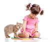 painting child girl with playful kitten