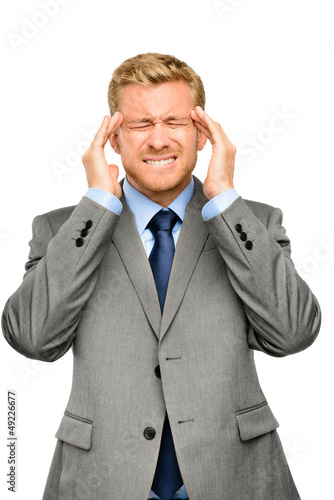 Worried young businessman suffering from headache
