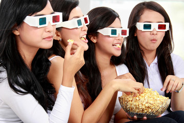 watching movie wearing 3d glasses