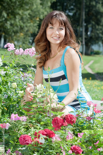 woman in flowers plant