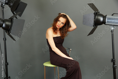 beautiful professional female model resting between shots in