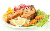 Appetizing grilled salmon with lemon and vegetables isolated
