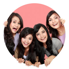 Group of beautiful women smiling peeping through circle hole