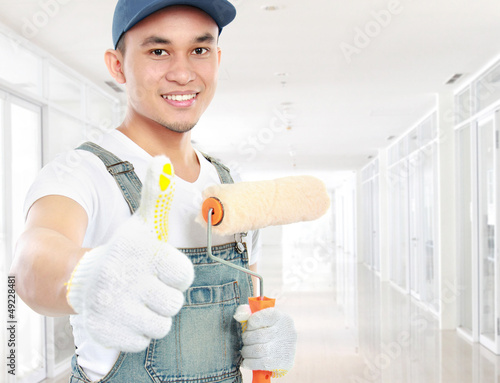 painter worker showing thumb up