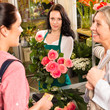 Women customers buying card flower shop pink