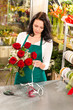 Woman florist working flowers roses market making