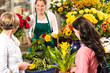 Florist woman preparing bouquet customers flower shop