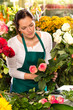 Woman florist preparing bouquet flowers shop retail