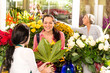 Young woman buying bouquet flower shop customer