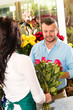 Husband buying roses bouquet romantic flower market