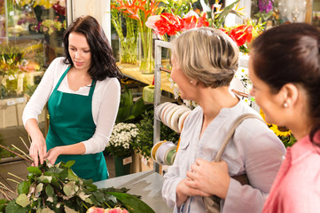 Young florist preparing cut flowers shop buyers
