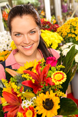 Smiling florist woman colorful bouquet flower market