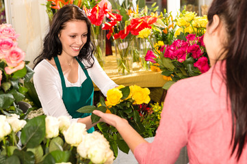 Cheerful flower shop florist customer buying yellow