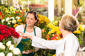 Senior customer buying red roses flower shop