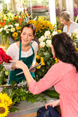 Young florist ordering roses woman customer flower