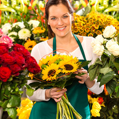 Smiling florist woman bouquet sunflowers flower shop