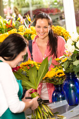 Cheerful woman buying bouquet flower shop florist